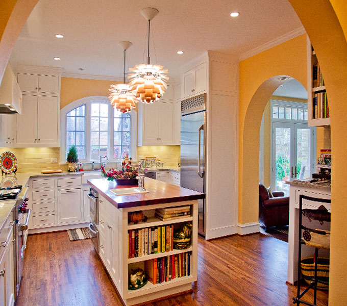 Photo of remodeled kitchen with site line into family room and outdoor patio.