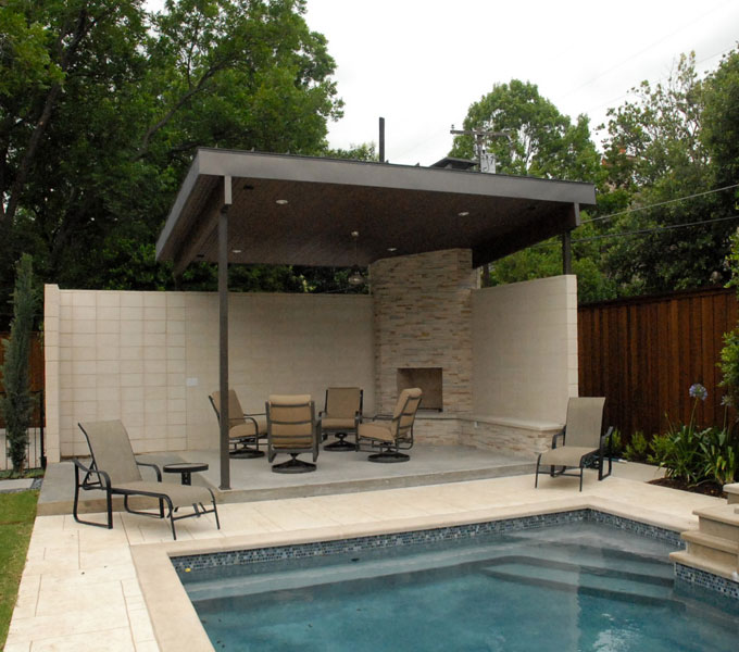 modern outdoor living spaces. mid sized elegant backyard patio