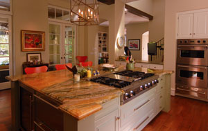 Photo of A kitchen remodel that is open to gatherings with a Tuscan feel